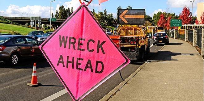 wreck ahead road sign