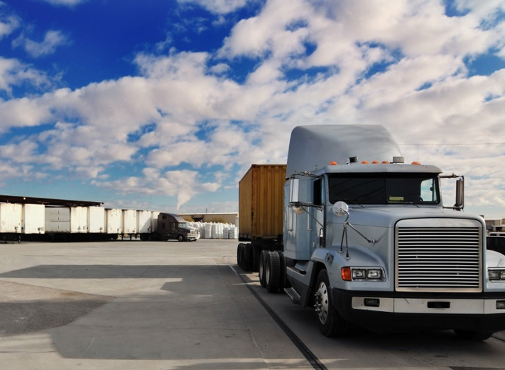 semi truck parked in docking station