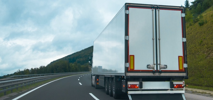 Rear view of a semi truck on the highway