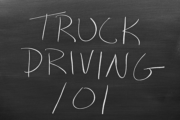 "The words ""Truck Driving 101"" on a blackboard in chalk truck driver training"