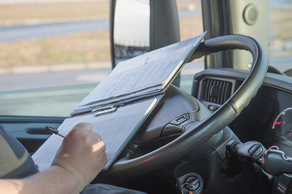 safety director truck driver writing